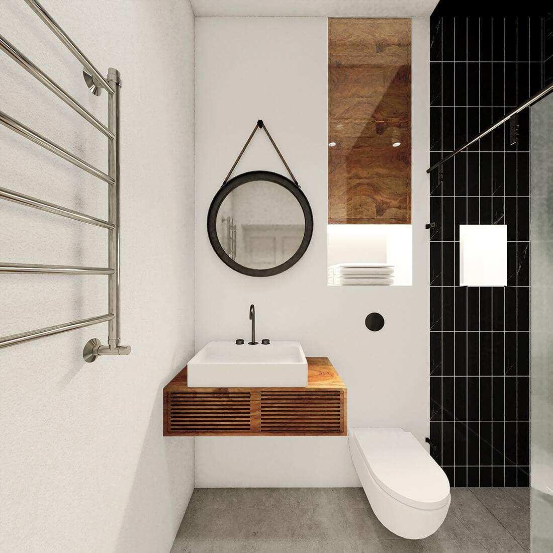 Minimalistyczna, czarno-biała łazienka w kamienicy