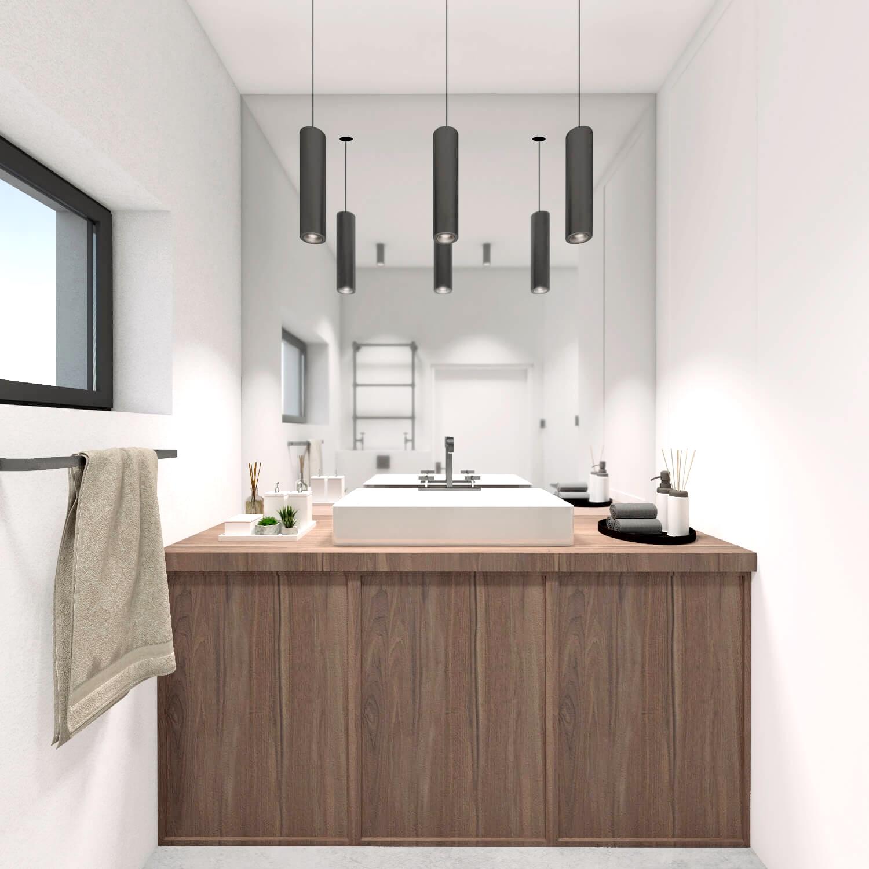 Biała łazienka z drewnianą zabudową pod pralkę i betonową podłogą