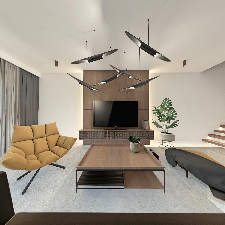 Pokój dzienny z żółtym fotelem, betonową podłogą i drewnem
