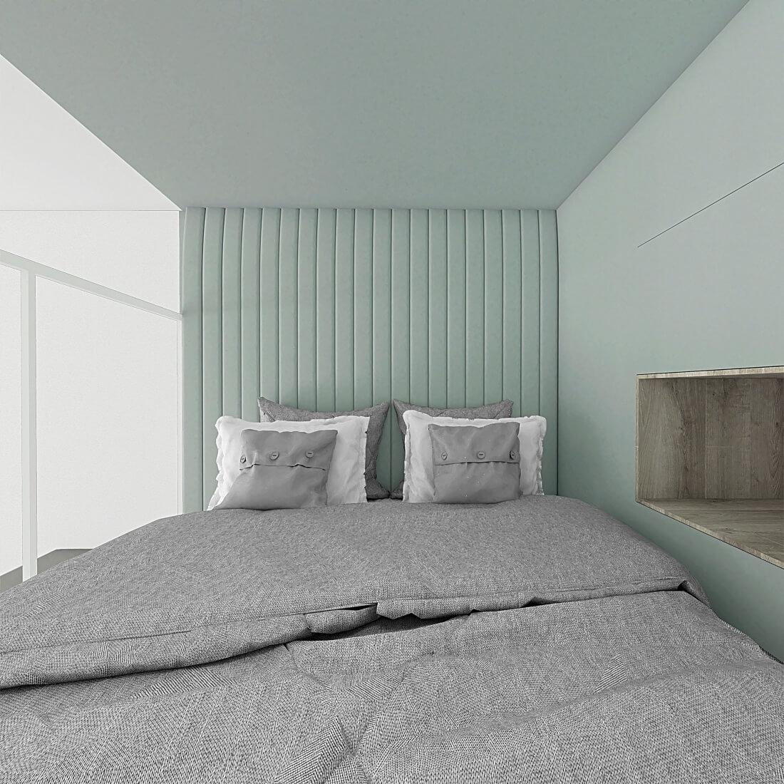 Zielony zagłówek w sypialni na antresoli