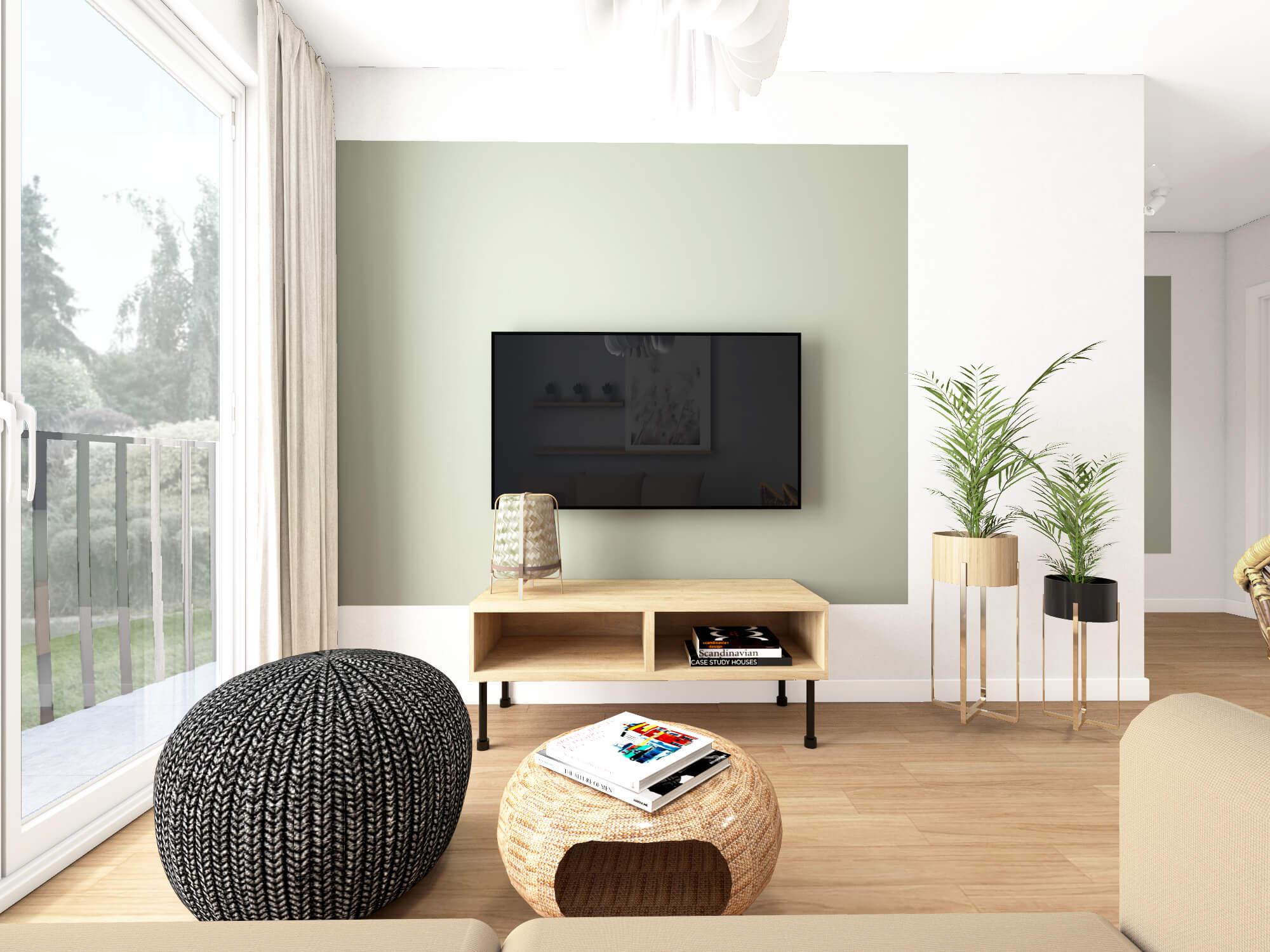 Salon w stylu Boho z zieloną ścianą