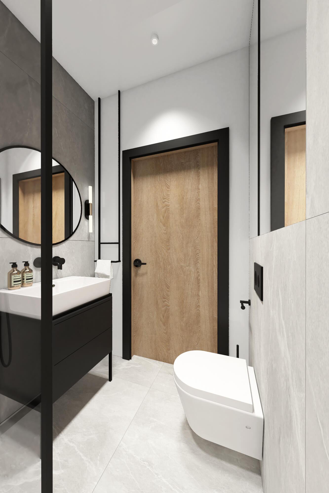mała łazienka z okrągłym lustrem